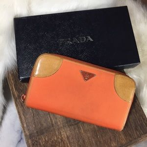 PRADA orange nylon tan leather long zip wallet